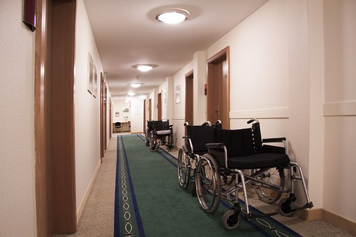 Wheelchairs sitting in a hallway